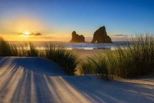 Sunset at Wharariki beach in New Zealand photo by Nico Babot