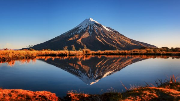 Sunset reflections of Taranaki in New Zealand photo by Nico Babot